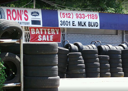 Ron's Tire and Battery Austin location with tires stacked